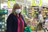 Brenda Elford wearing surgical face mask in Woolworths shopping centre