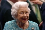 The Queen smiles and chats to Prime Minister Boris Johnson and another man at Windsor Castle.