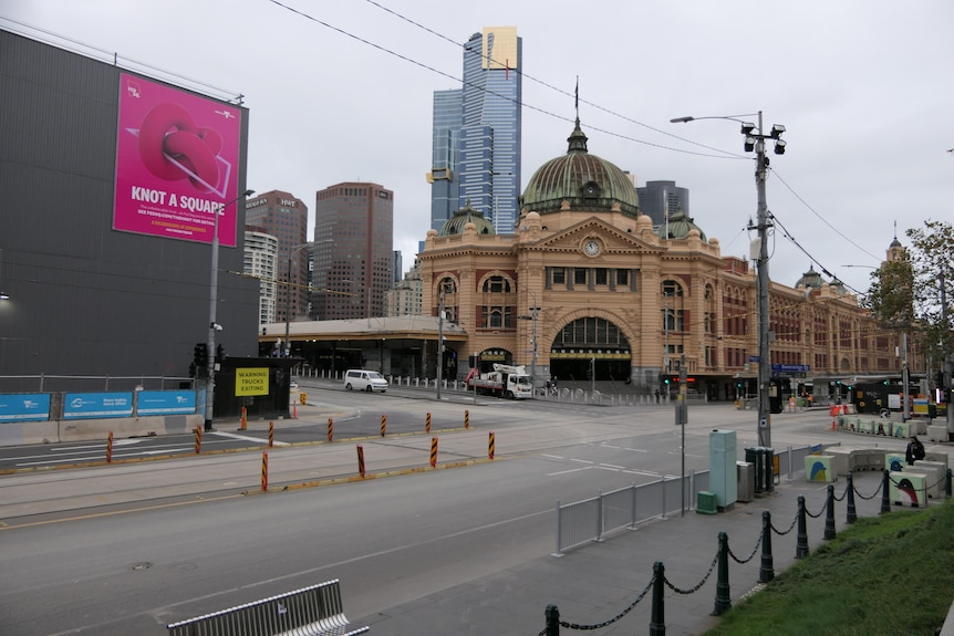 The intersection outside Flinders Street Station with no cars around.
