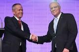 Scott Morrison and Bill Shorten shake hands ahead of the final leaders' debate.