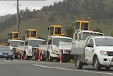 Civil contractors show off their new machinery in a convoy aimed at highlighting job losses on the NBN rollout.