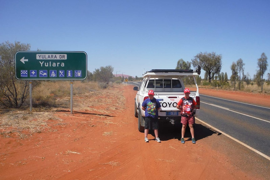 John Pyper's children stand in front of their father's ute at Yulara.