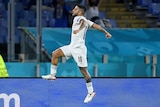 Lorenzo Insigne jumps in the air