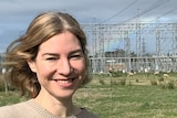 Woman in front of electrical substation