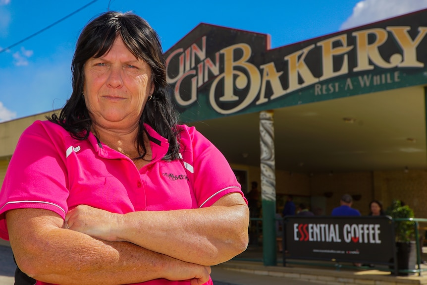 Gin Gin Bakery owner Maree Baker stands outside her shop with arms folded.
