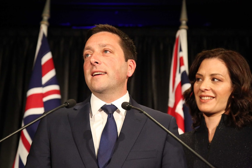 Matthew Guy looks out to the crowd with his wife Renae by his side.