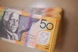 Stack of several thousand dollars worth of Australian $50 notes showing David Unaipon