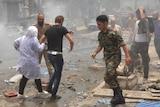 People evacuate the Al-Dabbeet hospital after it is hit by rocket fire.