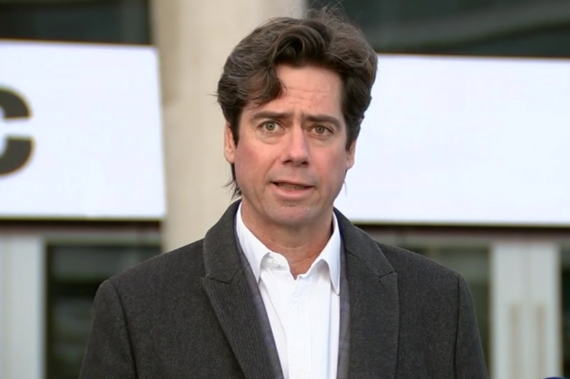 Gillon McLachlan speaks at a press conferences