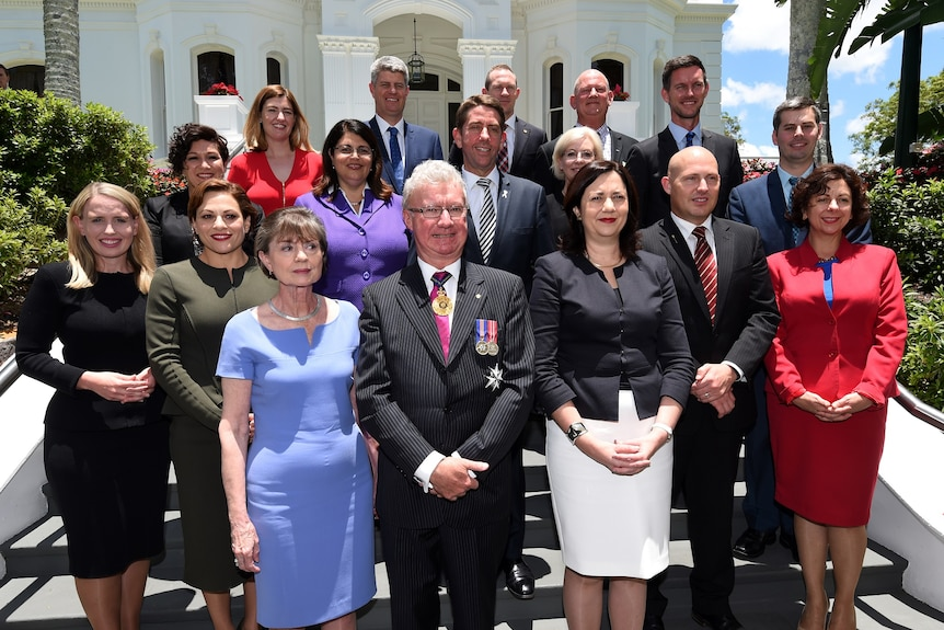 Queensland cabinet ministers pose for photo on the steps of Government House.