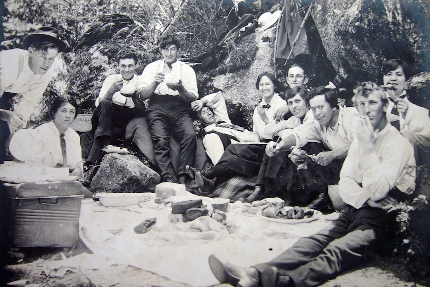 Rostrevor Hop Garden workers sitting around, drinking tea and having a picnic.