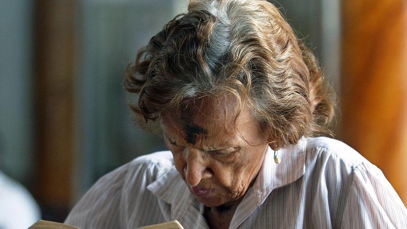 A Catholic woman reads the Bible