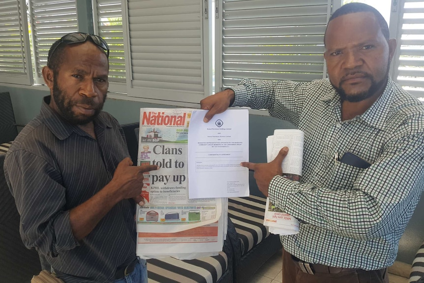 Landowners hold newspaper showing finance offer withdrawn