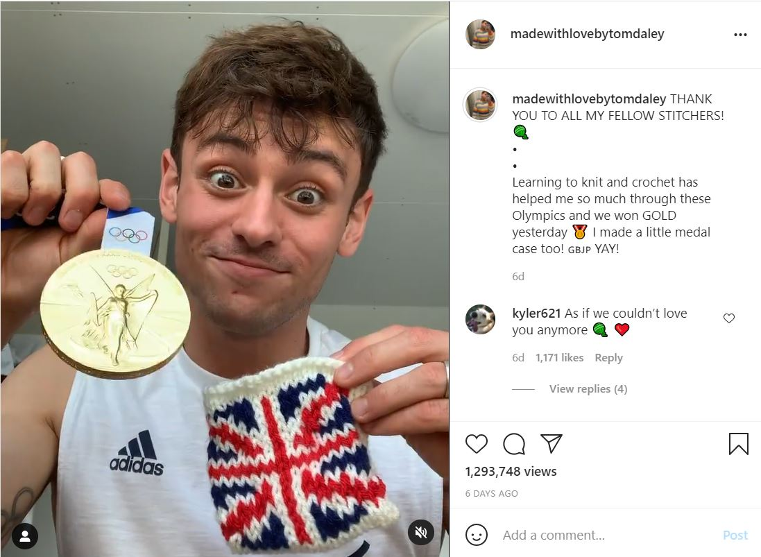 Tom Daley holds up a knitted cosy and his gold medal.