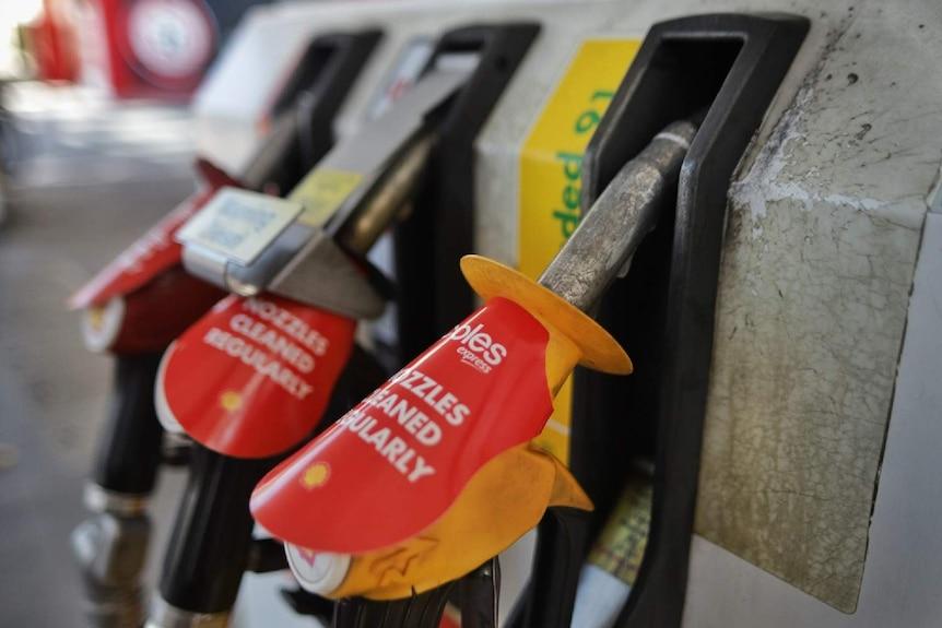 A close up of petrol pumps at a service station.