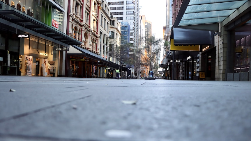 Empty retail strip in Sydney CBD, artistic shot from low down along pavement.