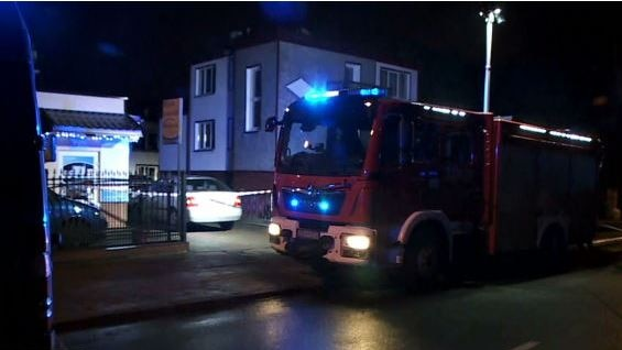 a fire engine outside an Escape Room in Koszalin, Poland