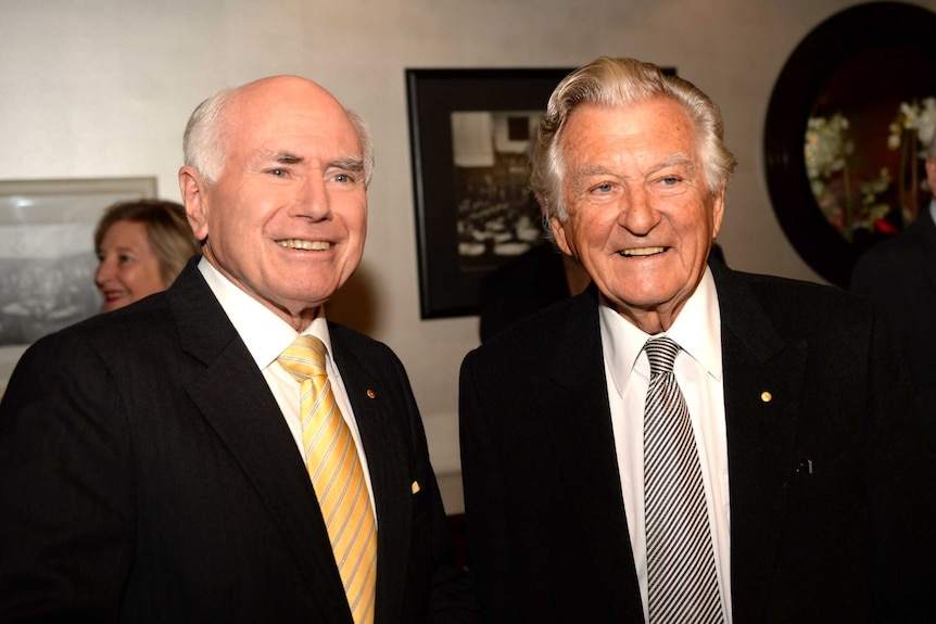 Former prime ministers LtoR John Howard and Bob Hawke at the National Press Club in Canberra.