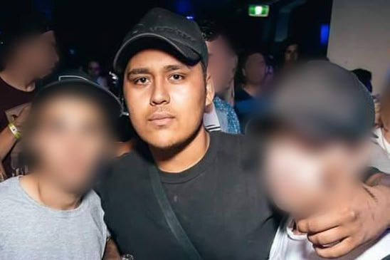 Teira Bennett pictured with two others, whose faces are obscured, at a nightclub.
