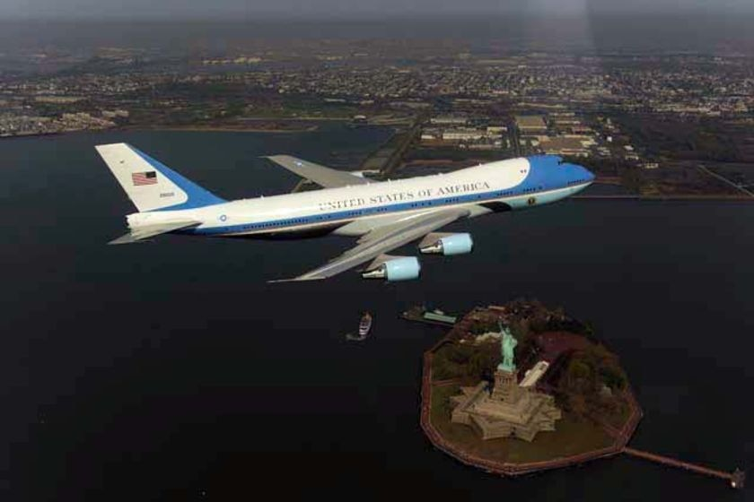 Air Force One flying over New York and the Statue Of Liberty