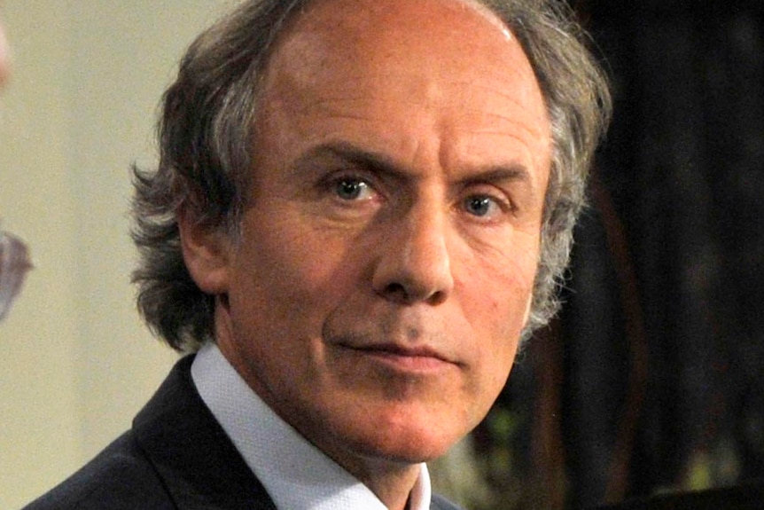 Dr Alan Finkel listens during a debate at the National Press Club.