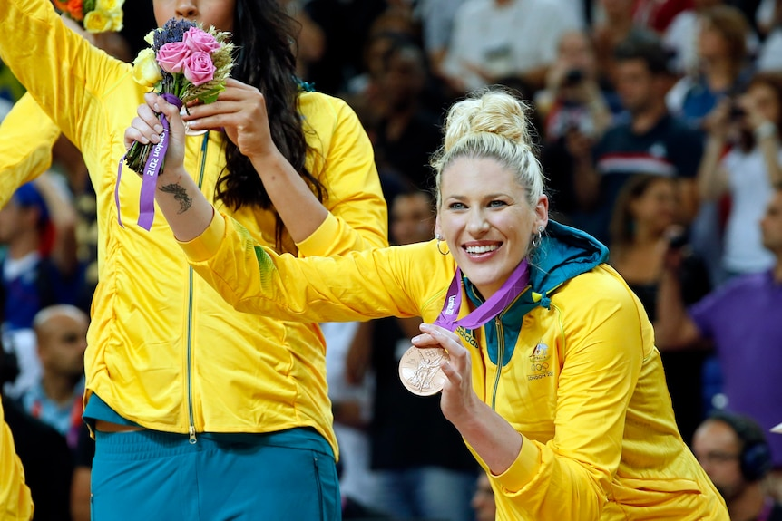 Australian Opeals player Lauren Jackson holds her bronze Olympic medal and a bouquet of flowers at the 2012 London Games.