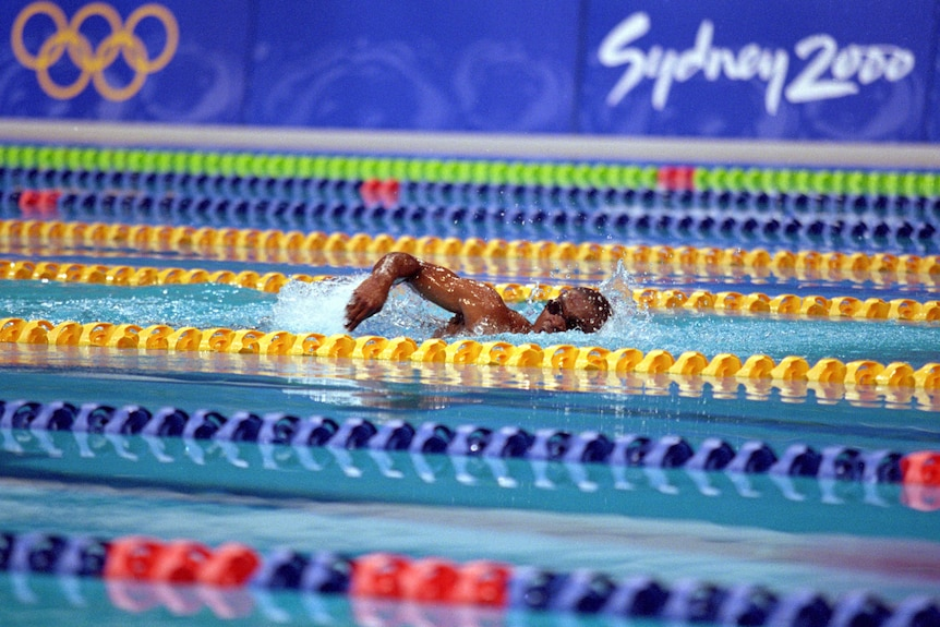 Eric Moussambani swims alone in the 100m freestyle heat at the Olympics.
