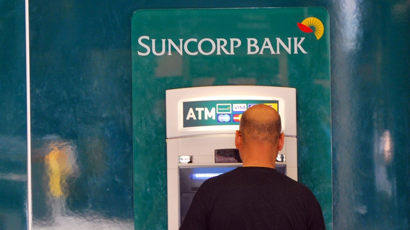 A man withdraws money from a Suncorp ATM in Brisbane