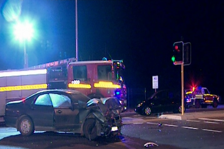 Two cars are badly damaged in a police pursuit car crash in Wattle Grove.