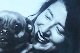 Joanna Nilson's black and white Twitter profile shows her posing with a pug dog.