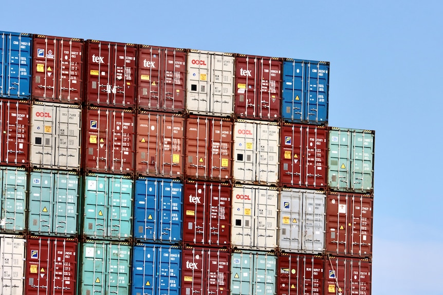 Shipping containers are stacked at a port