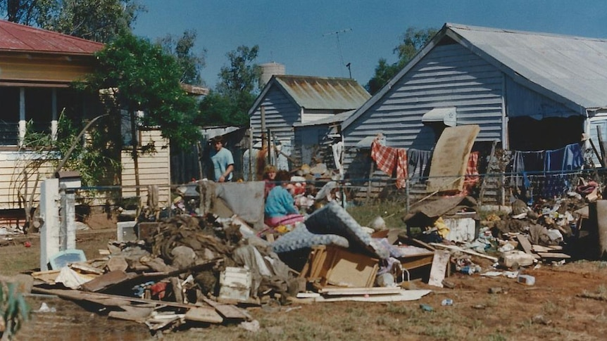 People outside a flood-damaged home in Charleville in 1990