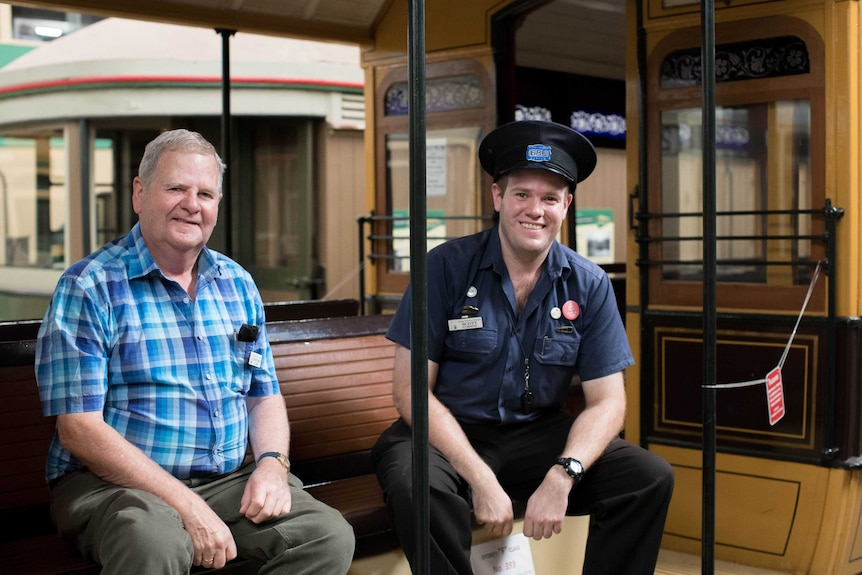 Howard Clarke and Scott Curnow sit on an old tram