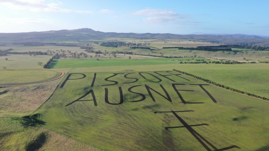 "Play Audio. A drone photo of a western Victorian farm with a paddock ploughed to read ""piss off Ausnet"". Duration: 4 minutes 54 seconds"