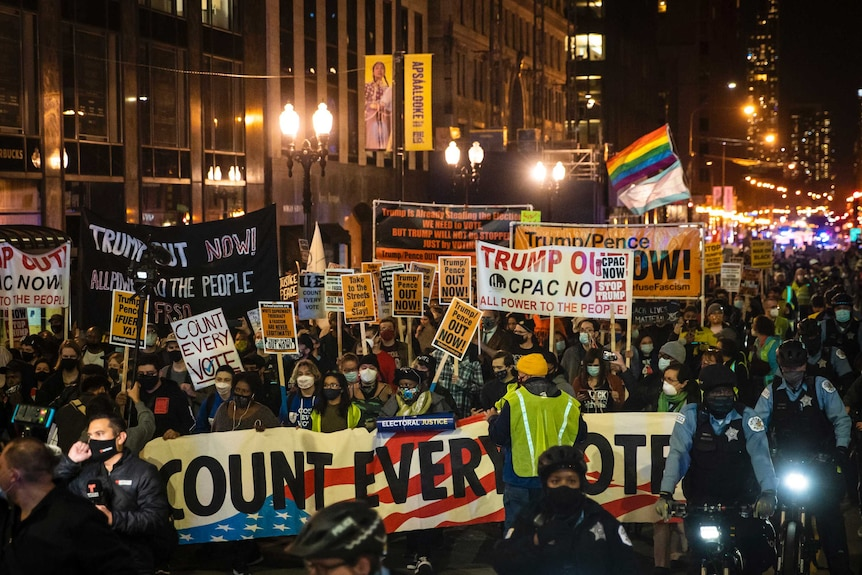 Hundreds of protesters march against Donald Trump through the Loop in Chicago