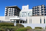 A wide shot of the exterior of Fiona Stanley Hospital exterior.
