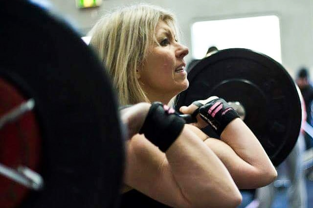 A shot from the gym of Deni Cameron performing a dead lift.