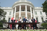 Donald Trump overseas diplomats from Israel, Bahrain and UAE signing an agreement in front of the White House.
