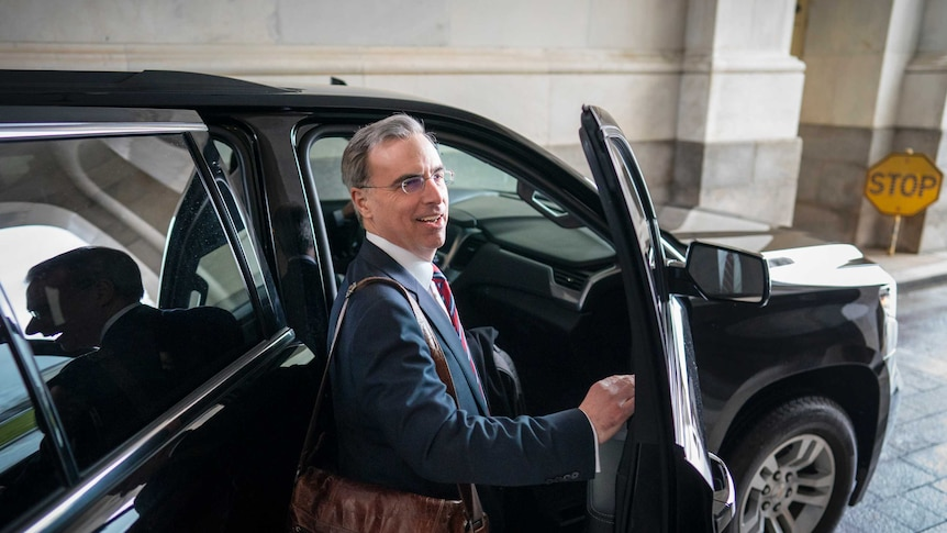 White House counsel Pat Cipollone gets into a car to leave.