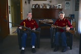 Betty Concanen and husband Merv sitting on chairs with their rifles resting across their laps.
