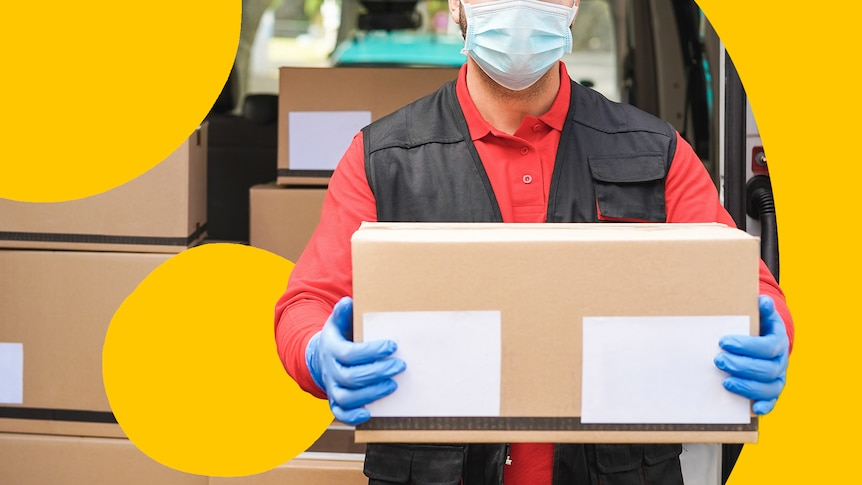 A man delivering parcels, wearing a disposable mask and gloves.