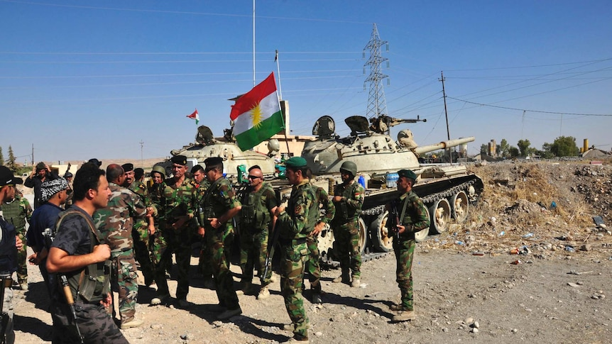 Members of the Kurdish security forces after clashes with militants of the Islamic State
