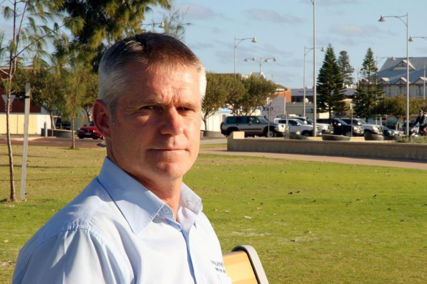 Head shot of Ian Blayney standing outside.