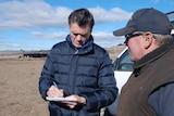 Michael Rowland speaks to farmer Sam White in Guyra, NSW.