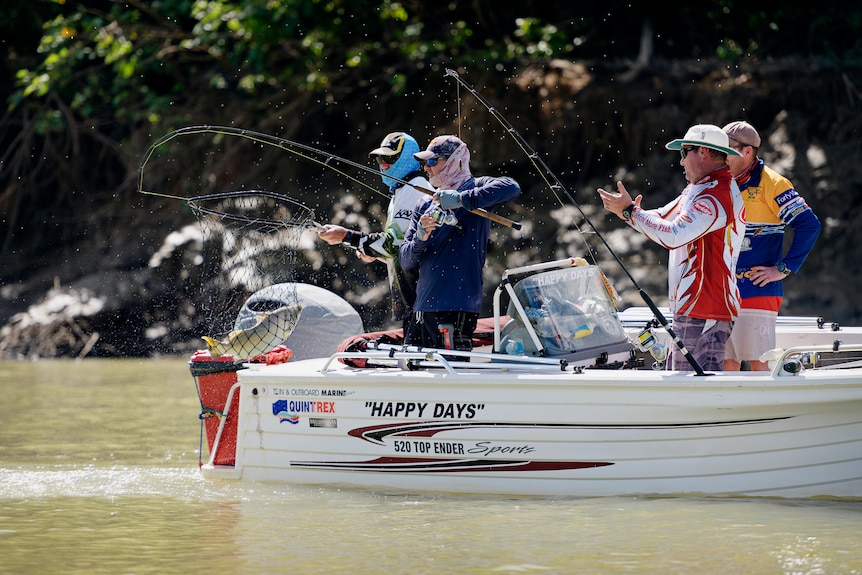Fishos reel in a barra on the Daly River.