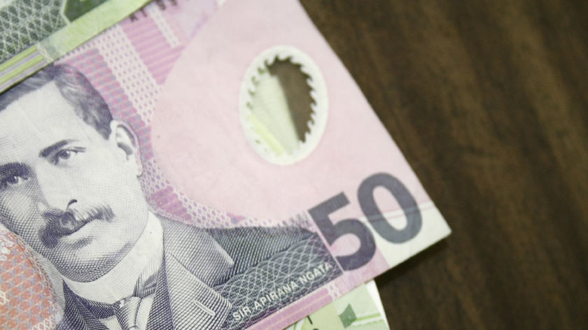Generic photo of New Zealand bank notes spread out on a table.