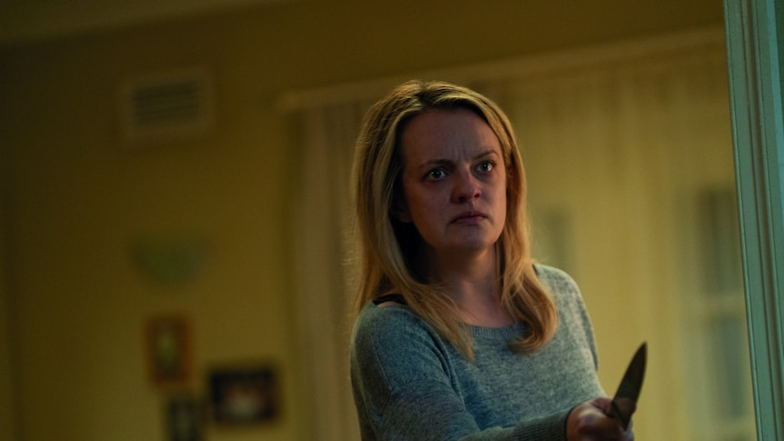 Elisabeth Moss, appearing distressed, holds a knife