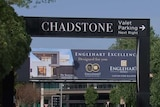 A large sign above a road says 'CHADSTONE'.