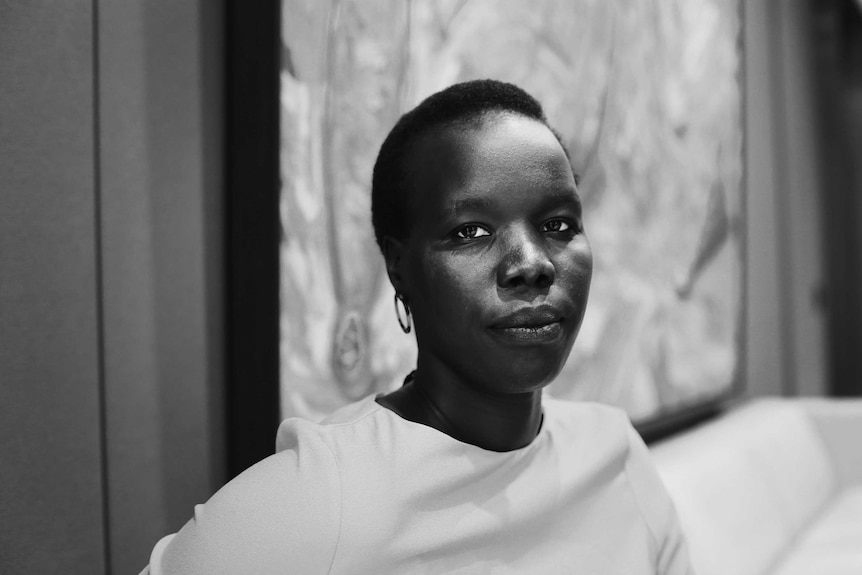 African woman with short hair looking at the calendar