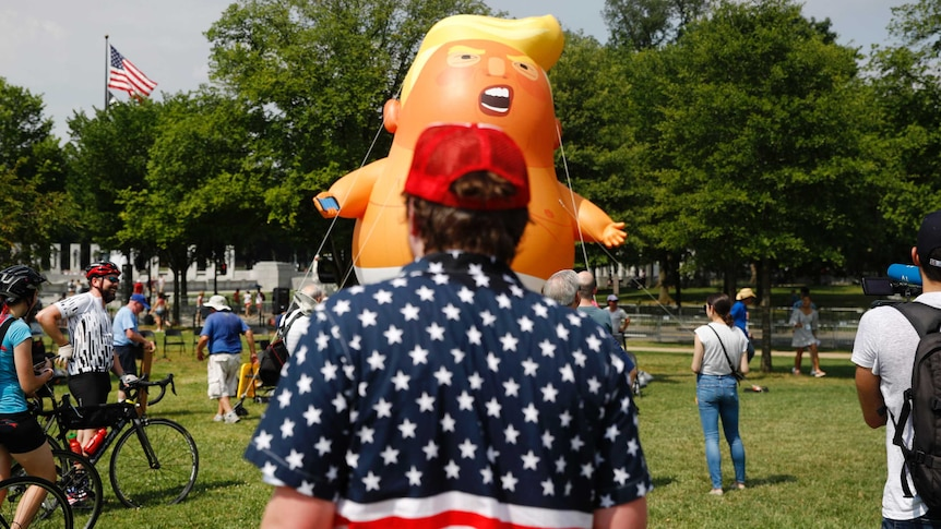 A Baby Trump balloon is tied down